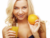 Woman holding orange juice — Stock Photo