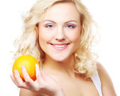 Portrait of a healthy happy woman with an orange — Stock Photo
