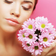Young womportrait with pink chrysanthemum — Stock Photo #31286183