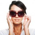 Beautiful fashion woman wearing sunglasses — Stock Photo
