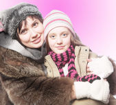 Beautiful mother daughter winter portrait — Stock Photo