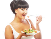 Young happy woman eating salad. — Stock Photo