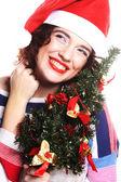 Santa woman holding tree — Stock Photo