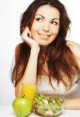 Woman has breakfast salad from fresh vegetables — Zdjęcie stockowe