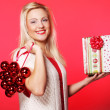 Young happy woman with a gift — Stockfoto