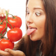 Beautiful young woman with ripe tomatoes — Stock Photo