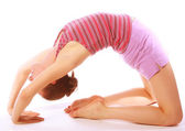 Shot of a sporty young woman doing yoga exercise. — Stock Photo