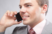 Young business man making a phone call — Stock Photo