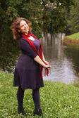 Fashion woman near the river in autumn season — Stock Photo