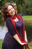Happy woman near the river in autumn season — Stock Photo