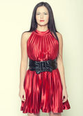 Woman in red dress with long dark hair — Stockfoto