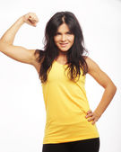 Young sporty woman flexing her biceps — Stock Photo