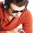 Young man listening to music on his headphones — Stock Photo