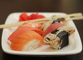 Sushi set on white plate — Stock Photo