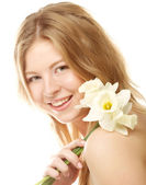 Girl smiling and with flower narcissus — Stock Photo