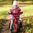 Little girl on a bicycle — Stock Photo