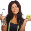 Healthy woman with apple and bottle of water. — Stock Photo