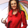 Woman in red coat with umbrella — Stock Photo #35719441