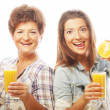 Stock Photo: Two women with orange juice.