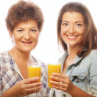 Two women with orange juice. — Stock Photo