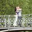 Couple walking on a bridge — Foto de Stock