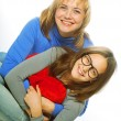 Young beautiful mother and her little daughter — Stock Photo