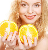 Blond woman with oranges in her hands — Stok fotoğraf