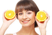 Young cheerful woman with oranges — Stock Photo