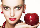 Beautiful woman with apple — Stock Photo