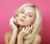 Blond woman over pink background — Stock Photo
