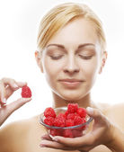 Woman eating a raspberry. Isolated over white — Stock Photo