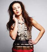 Fashion model on grey background — Stock Photo