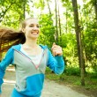 Stock Photo: Pretty young girl runner in forest.