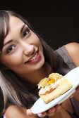 Beautiful young woman with a cake — Stock Photo