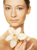 Girl holding orchid flower — Stock Photo