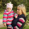 Happy mum with a daughter in autumn park — Stock Photo