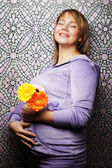 Pregnant woman with gerber — Stock Photo