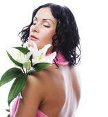 Krásná mladá žena s květinou — Stock fotografie