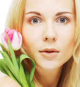 Blonde girl with tulip — Stock Photo