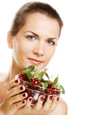 Woman with cherries over white — Stock Photo