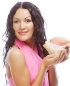 Attractive woman with marine shell — Stock Photo