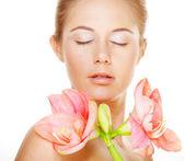 Beautiful woman holding pink flower — Stock Photo