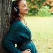 Enjoying music in autumn park — Stock Photo