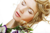 Beautiful woman with lilac flower — Stock Photo