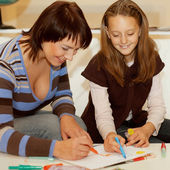 Mother and her daughter drawing. — Stock Photo