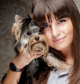 Young girl with her Yorkie puppy — Stock Photo
