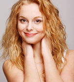 Glamour portrait of beautiful curly blonde girl — Stock Photo