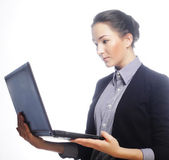 Young businesswoman holding a laptop — Stock Photo
