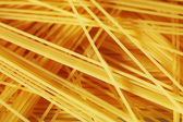 Raw pasta as whole background — Stockfoto
