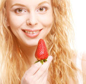 Happy smiling woman with strawberry — Stock Photo